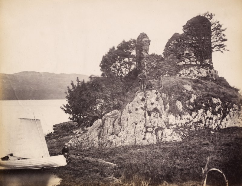 View of the ruins of the late medieval Finchard Castle with moored boat in the foreground, situated on the promontory near the south end of Loch Awe with the view of its eastern shore in the foreground, Lochawe, Kilmichael Glassary. Titled: '166. Fincharn Castle, Lochawe.' PHOTOGRAPH ALBUM NO 186: J B MACKENZIE ALBUMS vol.1