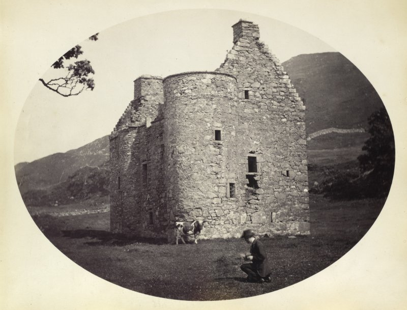 View of Kilmartin Castle ruined tower house with male figure and cow in foreground, Kilmartin, Argyll and Bute. Titled: '170. Kilmartin Castle, Argyll.' PHOTOGRAPH ALBUM NO 186: J B MACKENZIE ALBUMS vol.1