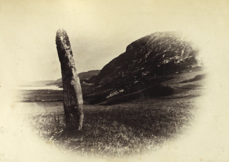 "View of one of two standing stones, originally thought to have been part of a stone circle known as ""Fingal's Limpet Hammers,"" at Lower Kilchattan, Colonsay. Titled: '29. Pillar Stone at Kilchattan, Colonsay.' PHOTOGRAPH ALBUM NO 186: J B MACKENZIE ALBUMS vol.1"