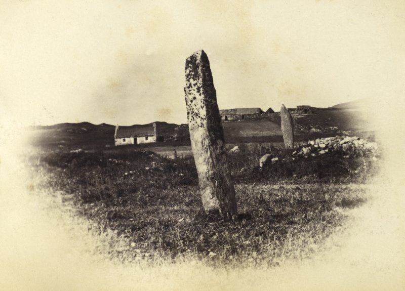 "View of the two standing stones, originally thought to have been part of a stone circle known as ""Fingal's Limpet Hammers,"" at Lower Kilchattan, Colonsay. Titled: '30. Pillar Stones at Kilchattan, Colonsay.' PHOTOGRAPH ALBUM NO 186: J B MACKENZIE ALBUMS vol.1"