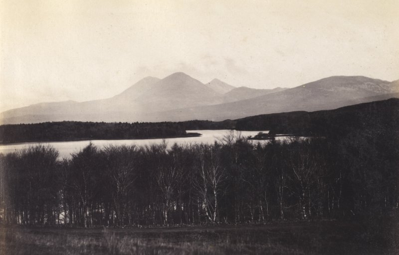 View of landscape and Loch Ballygrant with the Paps of Jura in background, at Loch Ballygrant, Islay. Titled: '35. Ballygrant Loch, Islay & Paps of Jura.' PHOTOGRAPH ALBUM NO 186: J B MACKENZIE ALBUMS vol.1