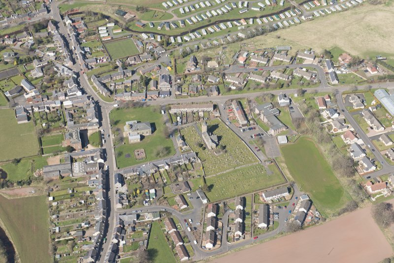 Oblique aerial view of Greenlaw, looking W.