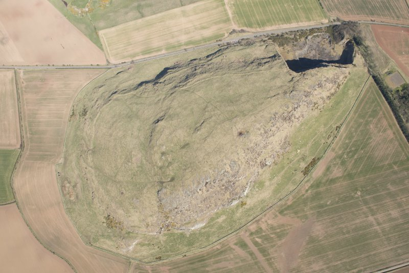 Oblique aerial view of Traprain Law, looking N.