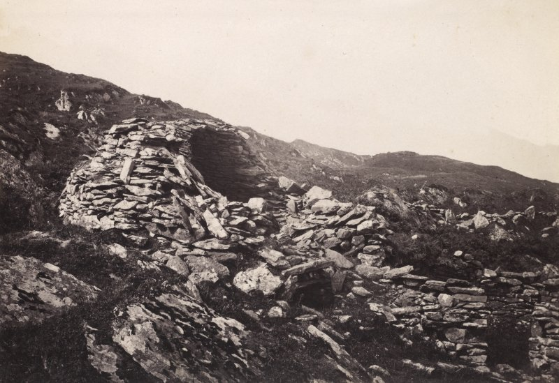 View of beehive cell and surroundings at Eileach An Naoimh, Argyll.  Titled: '44. Oven Shaped buildings on Ealan Naomh.' PHOTOGRAPH ALBUM, NO 186: J B MACKENZIE ALBUMS vol.1