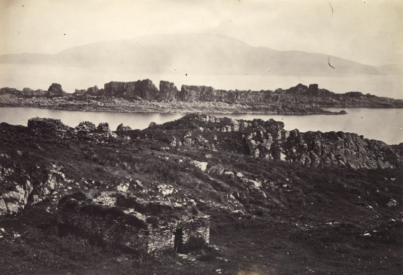 View, wide-angle, of ruins at Eileach An Naoimh, Argyll. The ruins of the ancient chapel are in the foreground. Titled: '47. Ruins of Ancient Chapel On Ealan Naomh.' PHOTOGRAPH ALBUM, NO 186: J B MACKENZIE ALBUMS vol.1