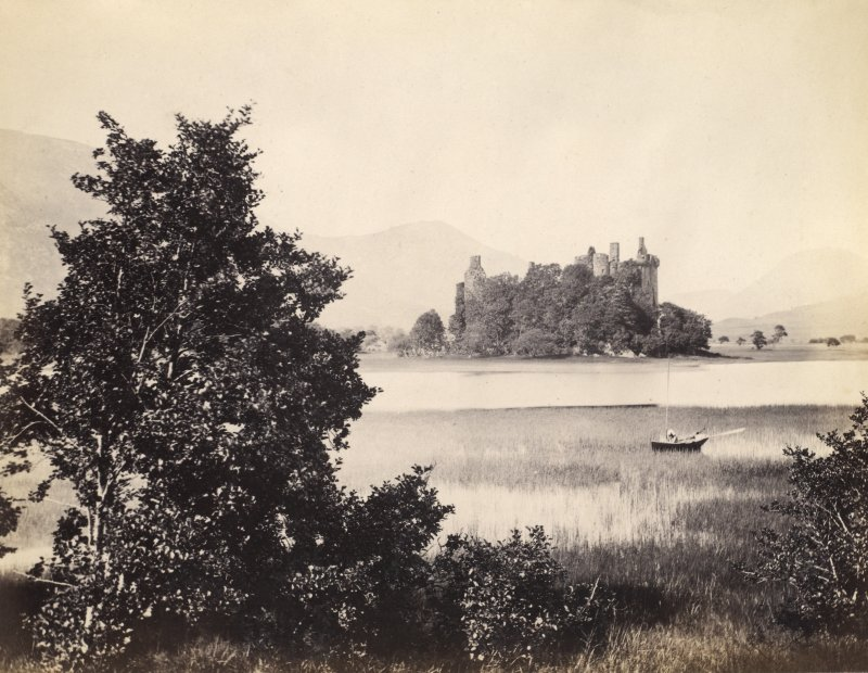 View of Kilchurn Castle with Loch Awe and surrounding landscape in the foreground, Kilchurn, Argyll and Bute. Titled: '123. Kilchurn Castle, Lochawe.' PHOTOGRAPH ALBUM NO 186: J B MACKENZIE ALBUMS vol.1