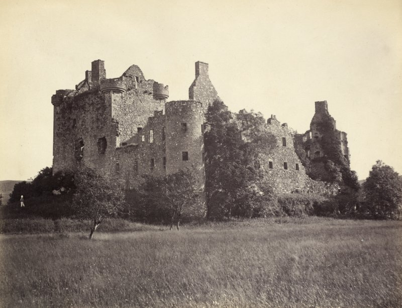 View of Kilchurn Castle surrounding fields in the foreground, Kilchurn, Argyll and Bute. Titled: '124. Kilchurn Castle, Lochawe.' PHOTOGRAPH ALBUM NO 186: J B MACKENZIE ALBUMS vol.1