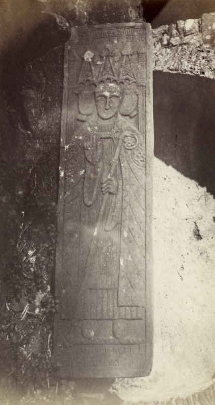 View of face of tapered graveslab bearing the effigy of Sir Donald MacDuffie, conventual Prior of Oransay. d.1555. From Oronsay Priory ruins, Oronsay, Argyll. The image has been given the title '38'. PHOTOGRAPH ALBUM No. 187, (cf PAs 186 and 188) Rev. J.B. MacKenzie of Colonsay Albums,1870, vol.2.