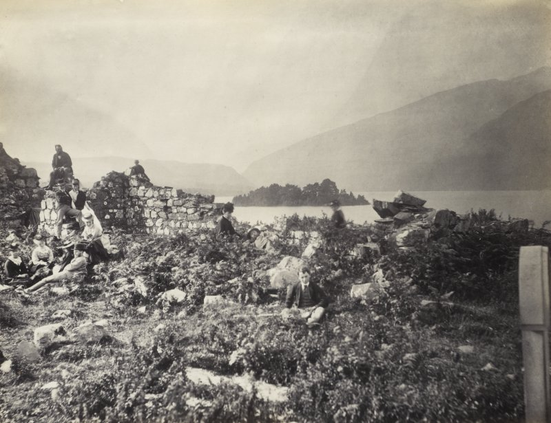 View of various seated figures upon the ruins of the old Inishail Parish Church, Lorn, Argyll.  Titled: 'Inishail'. PHOTOGRAPH ALBUM No. 187, (cf PAs 186 and 188) Rev. J.B. MacKenzie of Colonsay Albums,1870, vol.2.