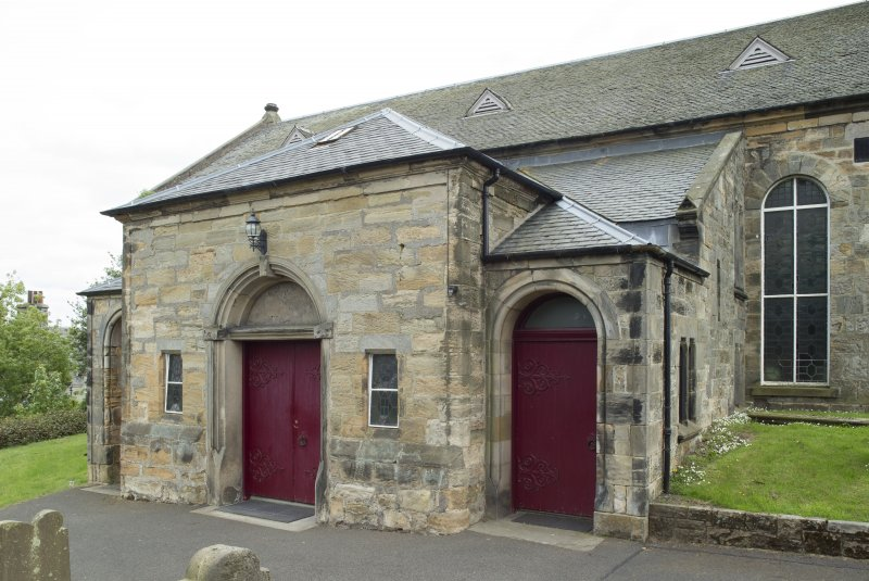 View from north west of former burial aisle converted to entrance of church, with flanking doors to gallery stairs.
