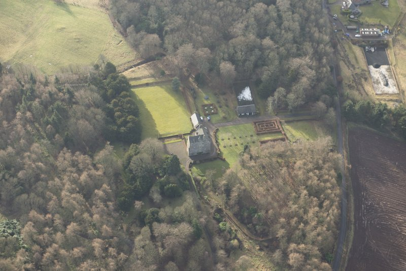 Oblique aerial view of Cleish Castle and gardens, looking WSW.