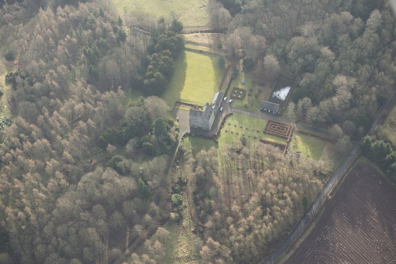 Oblique aerial view of Cleish Castle and gardens, looking SW.