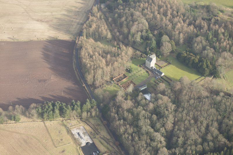 General oblique aerial view of Cleish Castle and gardens, looking ESE.
