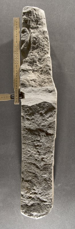 Inscribed cross slab (H.S. no. KMD003) right hand edge, flash with scale