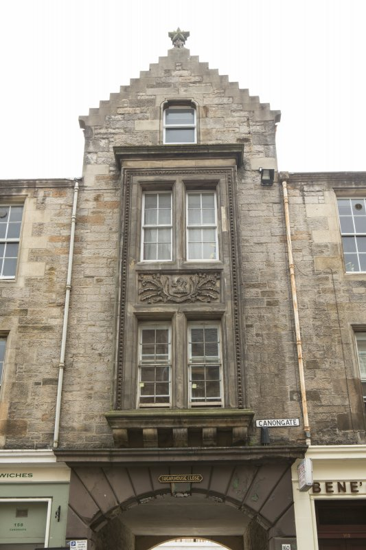 View of entrance to Sugarhouse Close at 160 Canongate, Edinburgh, showing carved panel between first and second floors.