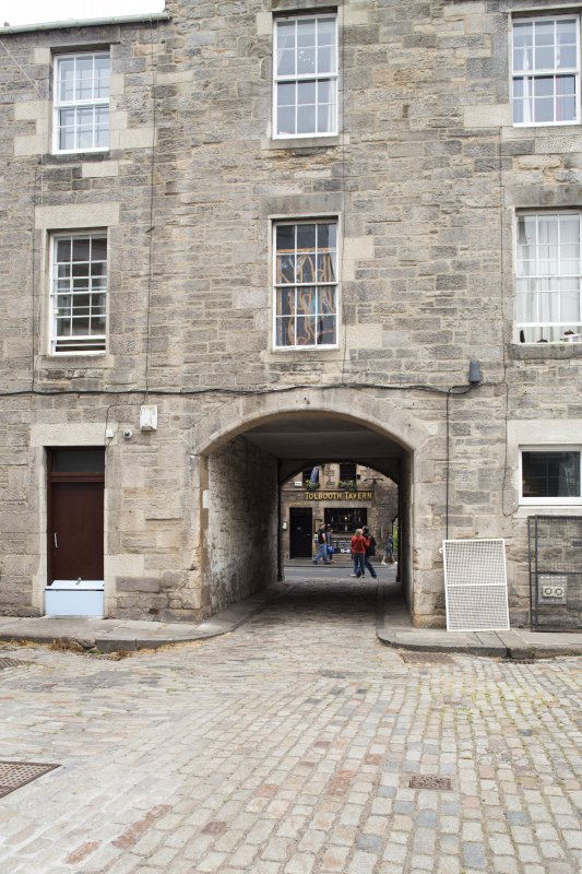View of arched pend leading from Canongate to Sugarhouse Close, Edinburgh, from S.