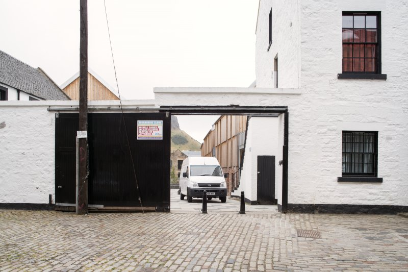 View of gates between former brewery buildings in Sugarhouse Close (off Canongate), Edinburgh, from N.