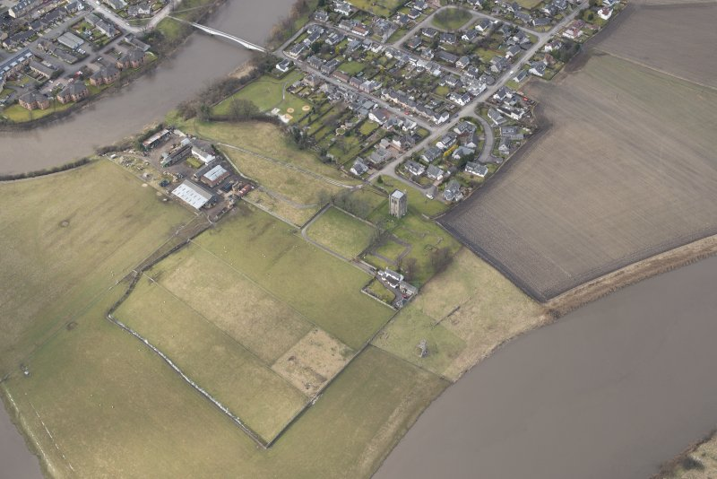 Oblique aerial view centred on the remains of the Abbey of Cambuskenneth, looking to the NE.