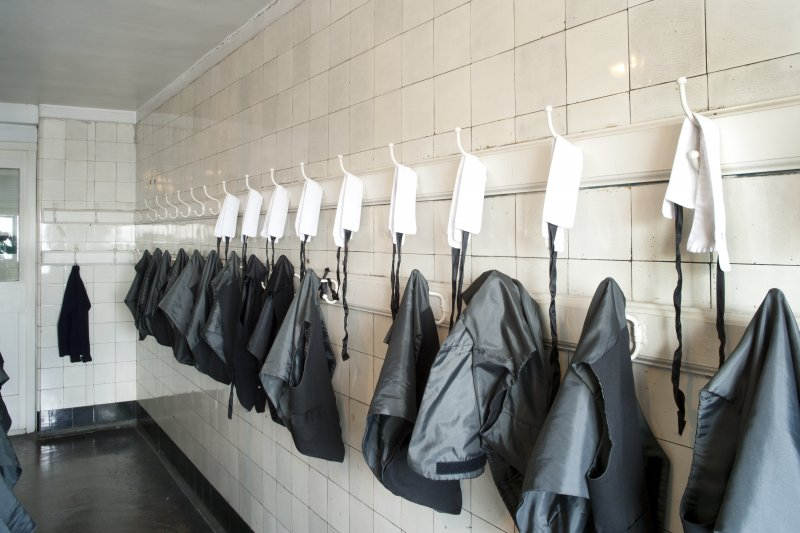 Interior. Detail of coat hooks in the second floor level boys' cloakroom.