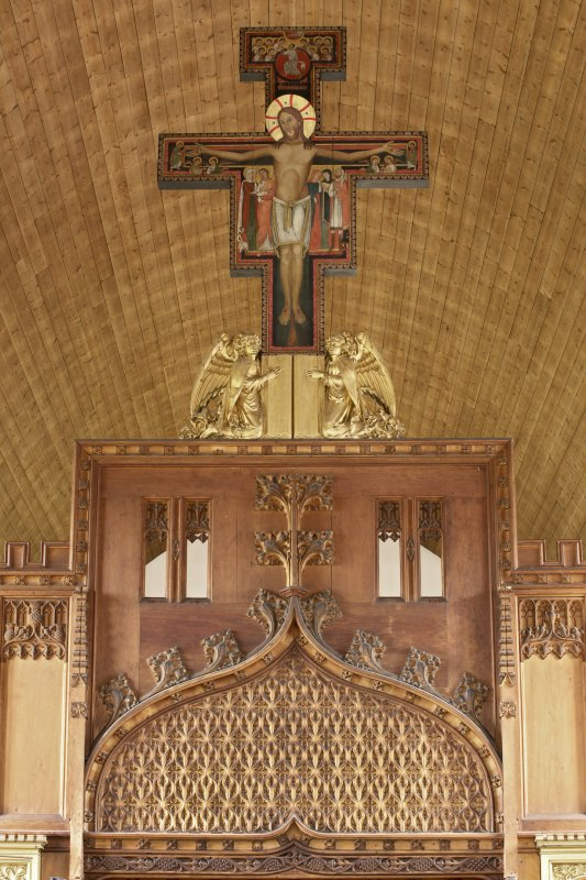 Interior. Church, rood loft, detail of cross with carved panel on screen below