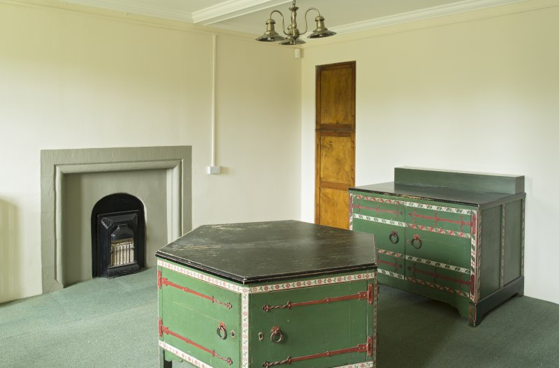 Interior. Ground floor, sacristy, view from north showing fireplace and painted cabinets