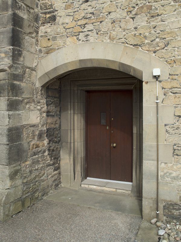 West range, view of doorway at north end