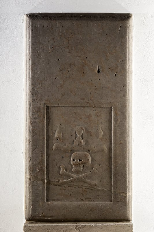 Interior. Church, detail of graveslab mounted against wall of nave