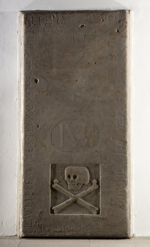 Interior. Church, detail of graveslab mounted against wall in nave