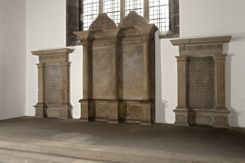 Interior. Church, view of memorials on wall at west end of nave