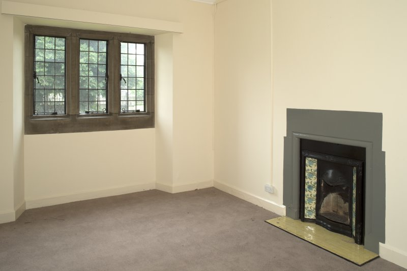 Interior. Ground floor, community wing, north room, view from north east showing window and fireplace