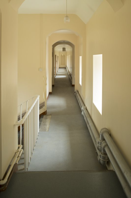 Interior. 1st floor, east range, corridor and landing, view from north