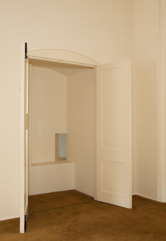Interior. 1st floor, east range, north room, view of cupboard with squinch