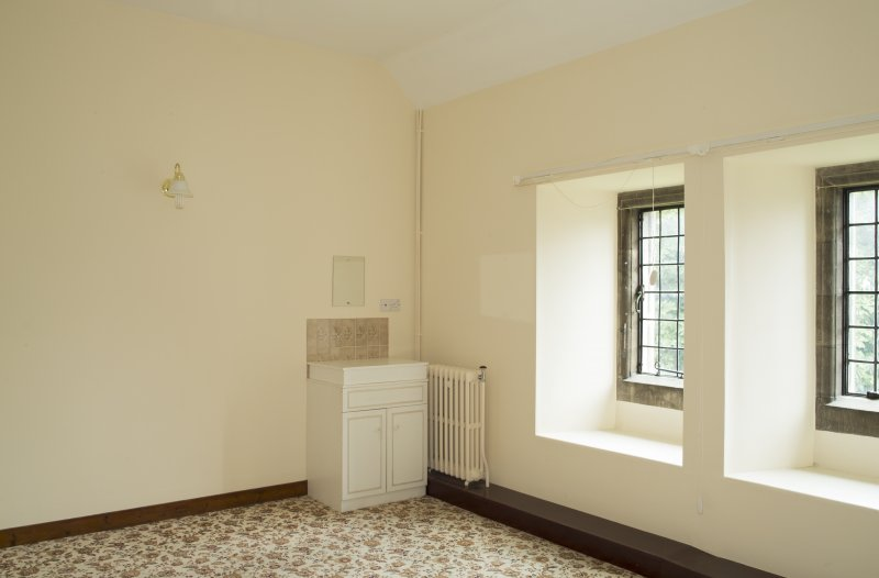 Interior. 1st floor, east range, view of specimen bedroom from south west