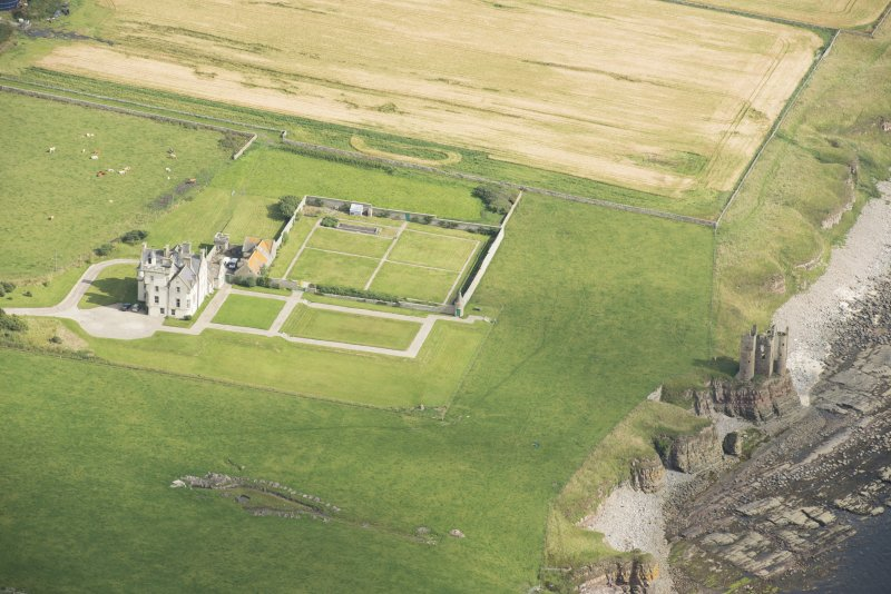 Oblique aerial view of Old Keiss Castle, Keiss Castle and walled garden, looking NE.
