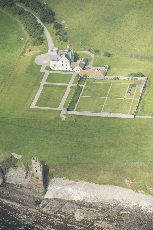 Oblique aerial view of Old Keiss Castle, Keiss Castle and walled garden, looking NW.