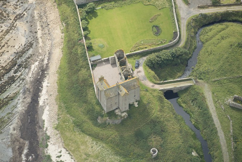 Oblique aerial view of Freswick Castle and bridge, looking SSE.