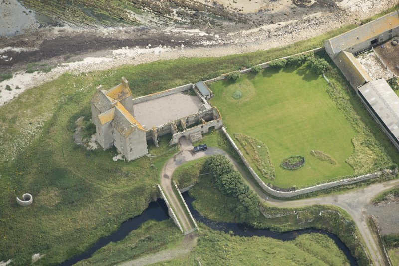 Oblique aerial view of Freswick Castle and bridge, looking E.