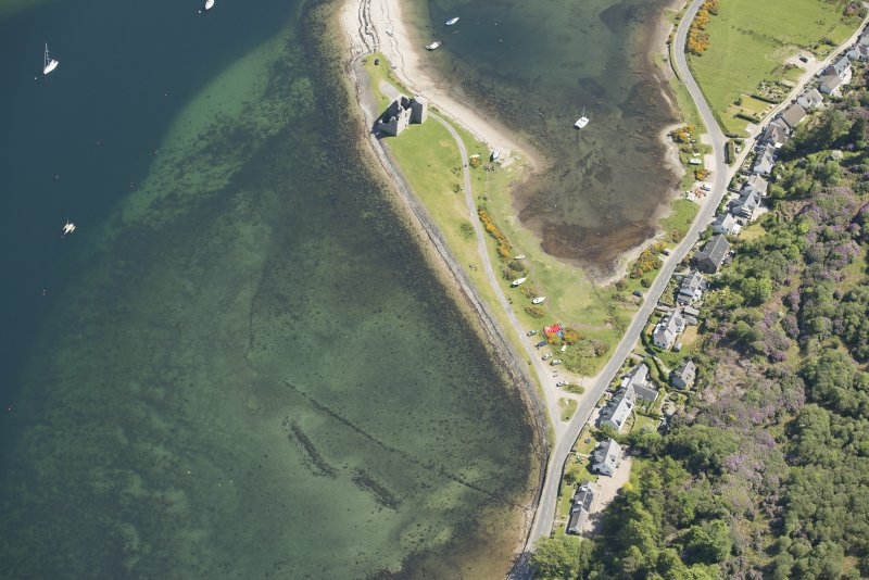 Oblique aerial view of Lochranza castle and fish trap, looking to the E.