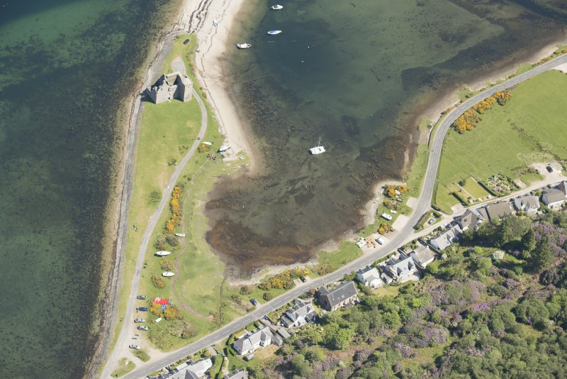 Oblique aerial view of Lochranza Castle and fish trap, looking to the ENE.