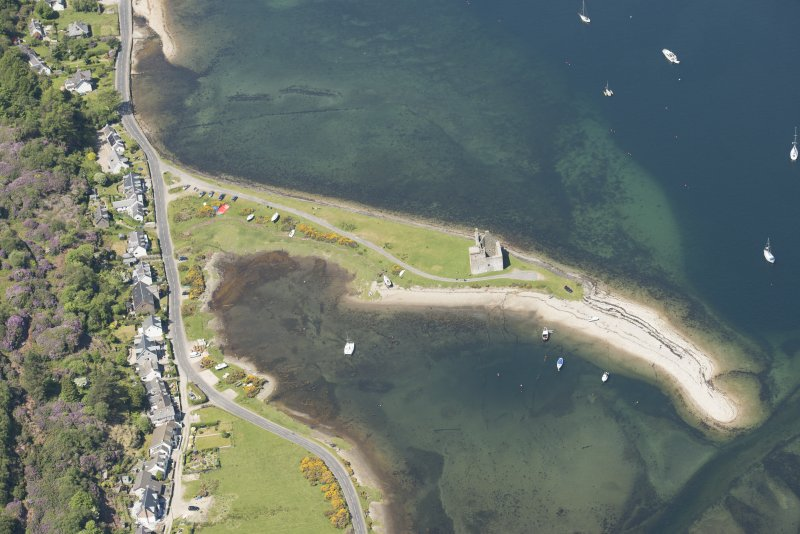 Oblique aerial view of Lochranza Castle and fish trap, looking to the NNW.