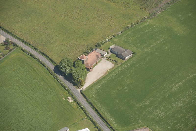 Oblique aerial view of St Molio's Church, looking to the E.