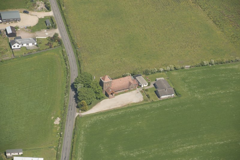 Oblique aerial view of St Molio's Church, looking to the NE.