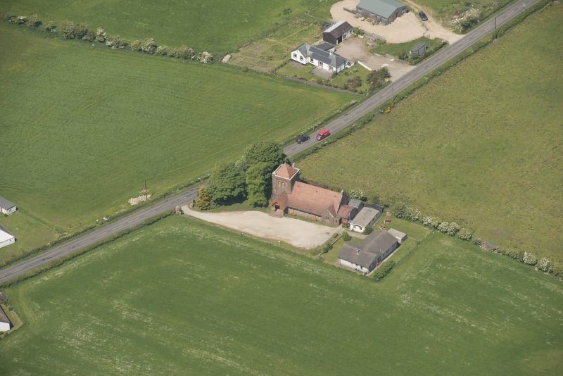 General oblique aerial view of the village of Shiskine centred on St Molio's Church, looking to the N.