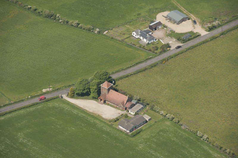Oblique aerial view of St Molio's Church, looking to the NNW.