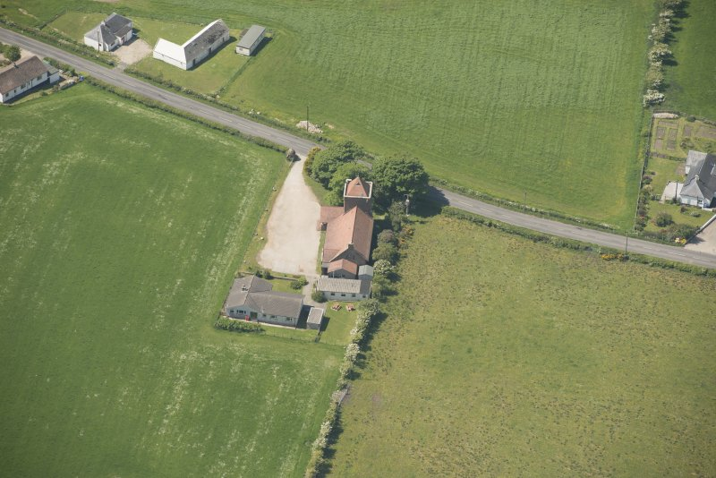 Oblique aerial view of St Molio's Church, looking to the W.