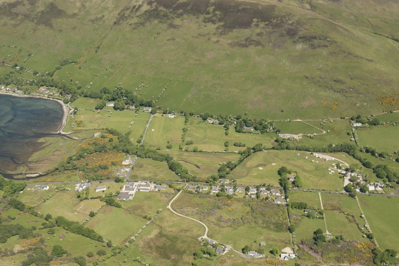 General oblique aerial view of Lochranza centred on the Isle of Arran Distillery and Golf Course, looking to the NNE.
