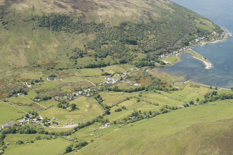 General oblique aerial view of Lochranza centred on Lochranza Golf Course with Lochranza castle adjacent, looking to the WSW.