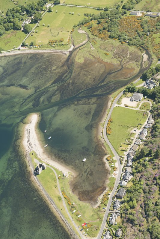 Oblique aerial view of Lochranza Castle with adjacent fish trap, looking to the WNW.