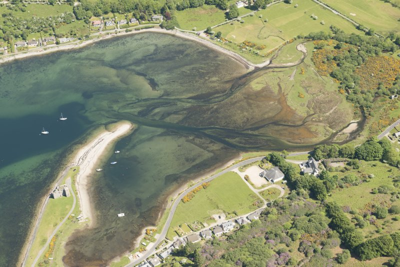 Oblique aerial view of Lochranza Castle with adjacent fish trap, looking to the NE.
