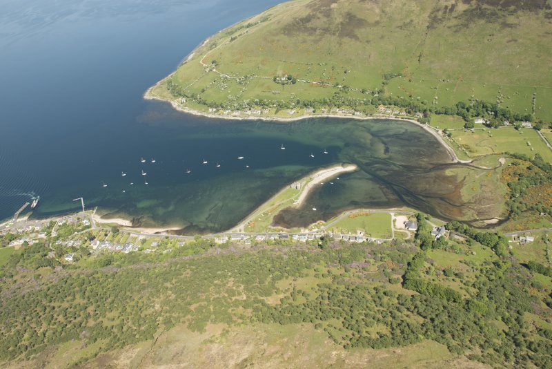 General oblique aerial view of Lochranza centred on Lochranza Castle, looking to the NNE.